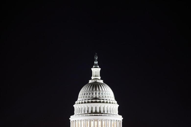 The U.S. Capitol dome is pictured in the pre-dawn darkness in this general view taken in Washington, October 18, 2013. REUTERS/Jonathan Ernst