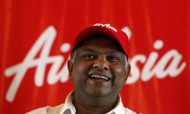 AirAsia Group CEO Tony Fernandes smiles during a news conference in Mumbai July 1, 2013. REUTERS/Vivek Prakash