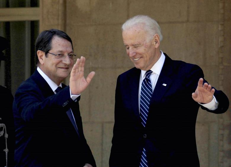 U.S. Vice President Joe Biden (R) and Cypriot President Nicos Anastasiades wave as they meet at the presidential palace in Nicosia May 22, 2014. REUTERS/Andreas Manolis