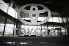 A Toyota logo is seen in a showroom at a Toyota dealership in Warsaw April 11, 2014. REUTERS/Kacper Pempel