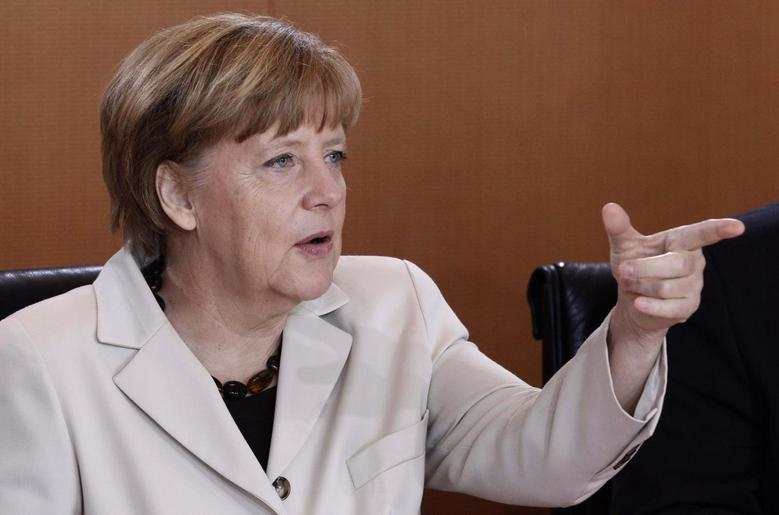 German Chancellor Angela Merkel awaits the start of the weekly cabinet meeting in Berlin May 14, 2014. REUTERS/Tobias Schwarz