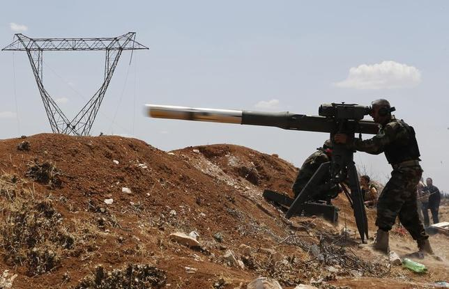 A Free Syrian Army fighter fires a weapon towards forces loyal to Syria's President Bashar al-Assad, in the town of Morek in Hama province May 22, 2014. REUTERS/Badi Khlif