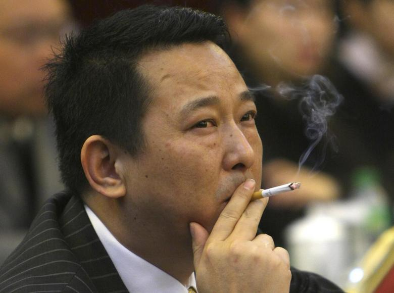 Liu Han, former chairman of Hanlong Mining, smokes a cigarette during a conference in Mianyang, Sichuan province, in this picture taken March 21, 2008. REUTERS/Stringer