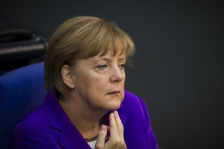 German Chancellor Angela Merkel listens during a session of the Bundestag, the lower house of parliament, in Berlin, May 8, 2014. REUTERS/Thomas Peter