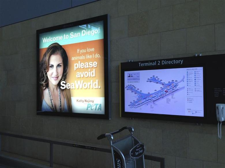A People for the Ethical Treatment of Animals (PETA) poster featuring actress Kathy Najimy is pictured at the San Diego County Regional Airport, in this handout photo taken May 21, 2014, courtesy of PETA. REUTERS/PETA/Handout via Reuters