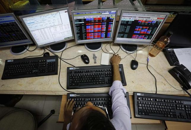 A broker monitors share prices while trading at a brokerage firm in Mumbai May 13, 2014. REUTERS/Danish Siddiqui