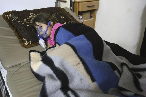A girl, affected by what activists say was a gas attack, receives treatment inside a makeshift hospital in Kfar Zeita village in the central province of Hama May 22, 2014. REUTERS-Badi Khlif