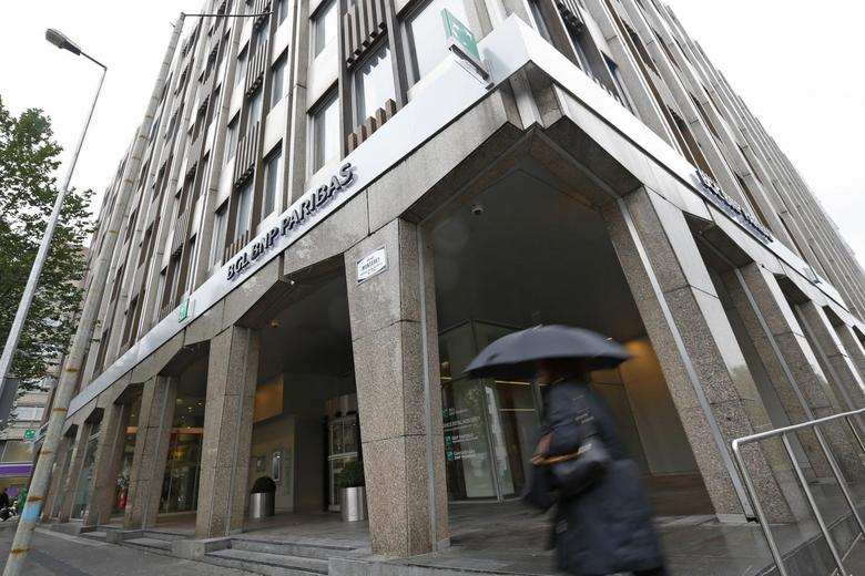A pedestrian walks past a BGL BNP Paribas bank building in Luxembourg, September 11, 2013. REUTERS/Yves Herman