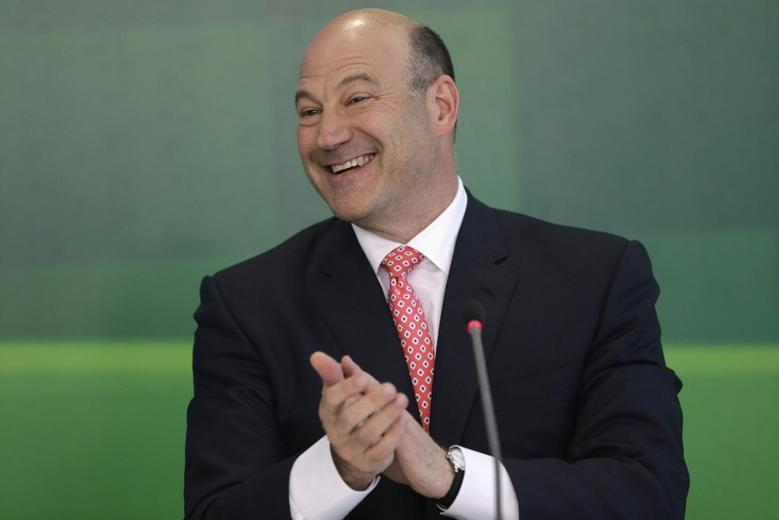 Gary Cohn, president and COO of Goldman Sachs, speaks during a news conference, after a meeting with Brazil's President Dilma Rousseff in Brasilia April 9, 2014. REUTERS/Ueslei Marcelino