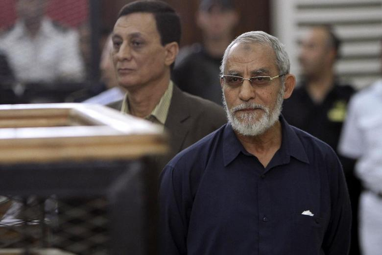 Muslim Brotherhood's Supreme Guide Mohamed Badie (R) looks on during his trial at a court in Cairo, May 18, 2014. REUTERS/Al Youm Al Saabi Newspaper
