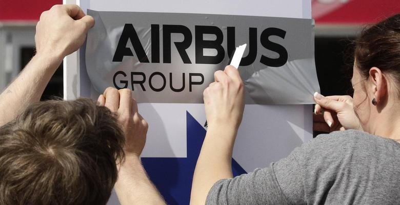 Volunteers prepare an Airbus sign for the upcoming ILA Berlin Air Show in Selchow near Schoenefeld south of Berlin May 19, 2014. The ILA runs from May 20 till 25. REUTERS/Tobias Schwarz