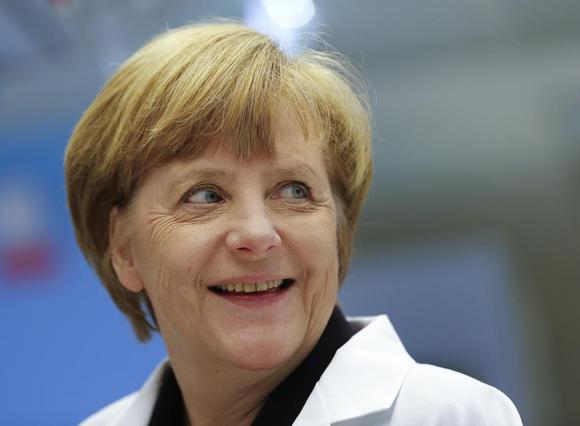 German Chancellor Angela Merkel smiles during her visit at a factory of Swiss pharmaceutical company Roche in Penzberg May 5, 2014. REUTERS/Michael Dalder