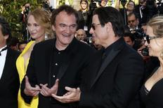 "Director Quentin Tarantino (2ndL), actress Uma Thurman (L), actor John Travolta (2ndR) and his wife Kelly Preston pose on the red carpet they arrive for the screening of the film ""Sils Maria"" (Clouds of Sils Maria) in competition at the 67th Cannes Film Festival in Cannes May 23, 2014.  REUTERS/Benoit Tessier"