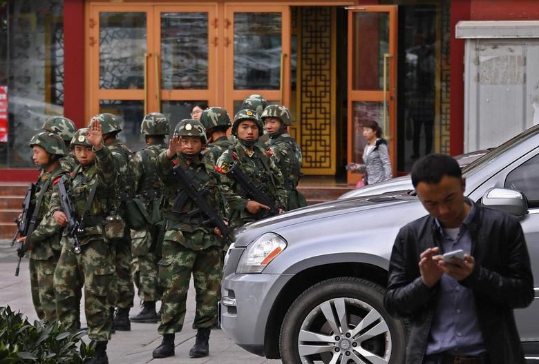 Chinese state media says five suicide bombers carried...