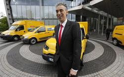 Frank Appel, CEO of German postal and logistics group Deutsche Post DHL poses in front of a StreetScooter E-car and other E-cars in Bonn May 21, 2013. REUTERS/Wolfgang Rattay