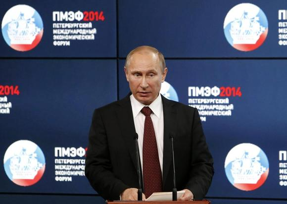 Russia's President Vladimir Putin delivers a speech during the ''Oil and gas companies as an engine driving change in the world economy'' session at the St. Petersburg International Economic Forum 2014 (SPIEF 2014) in St. Petersburg May 24, 2014. REUTERS/Sergei Karpukhin