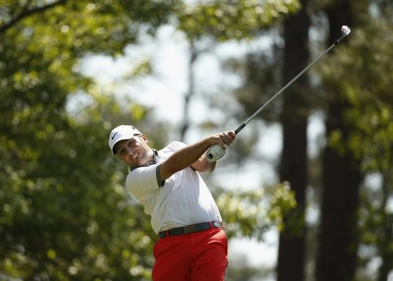 Francesco Molinari of Italy tees off on the fourth hole during the third round of the Masters golf tournament at the Augusta National Golf Club in Augusta, Georgia April 12, 2014. REUTERS/Jim Young