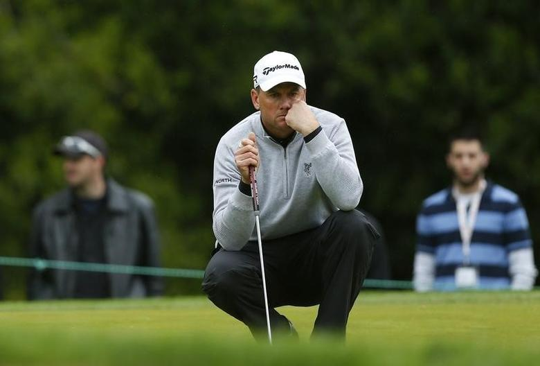 Robert Karlsson of Sweden lines up a putt on the fourth hole during the final round of the Wells Fargo Championship PGA golf tournament at the Quail Hollow Club in Charlotte, North Carolina May 5, 2013. REUTERS/Chris Keane
