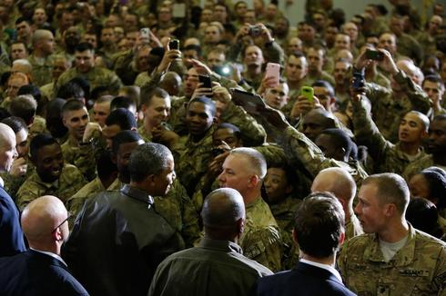 Obama, in Afghanistan visit, says he's hopeful on security pact