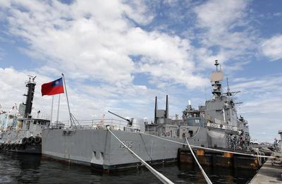 As Taiwan beefs up prized South China Sea outpost,...