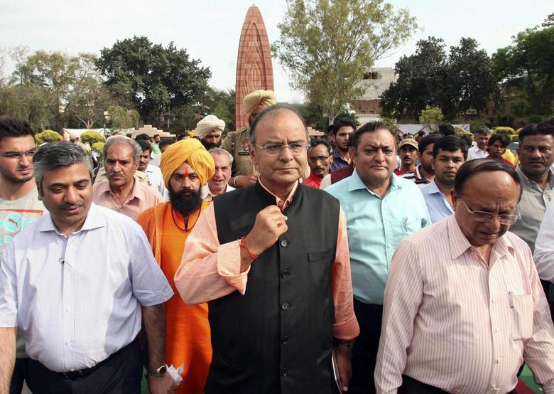 Arun Jaitley (C), a senior leader of India's main opposition Bharatiya Janata Party (BJP), arrives to pay homage at the Jallianwala Bagh memorial in the northern Indian city of Amritsar April 13, 2014. REUTERS/Munish Sharma