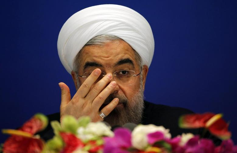 Iran's President Hassan Rouhani attends a news conference at a hotel after the fourth Conference on Interaction and Confidence Building Measures in Asia (CICA) summit, in Shanghai May 22, 2014. REUTERS/Carlos Barria