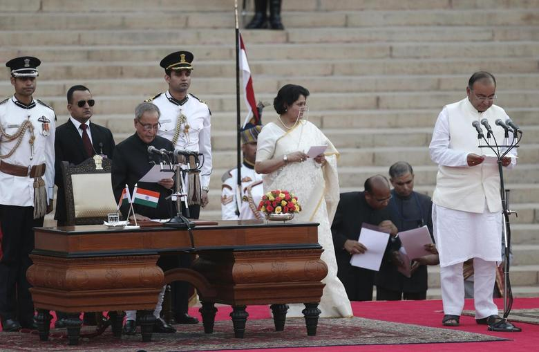 India's President Pranab Mukherjee (3rd L) administers the oath of office to Arun Jaitley (R) as a cabinet minister at the presidential palace in New Delhi May 26, 2014. REUTERS/Adnan Abidi