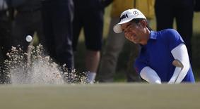 China's Liang Wenchong hits from a bunker onto the ninth green during the second day of the European Tour Hong Kong Open golf tournament December 6, 2013.  REUTERS/Bobby Yip