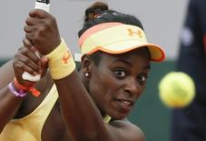 Sloane Stephens of the U.S. eyes the ball during a women's singles match against Peng Shuai of China at the French Open tennis tournament at the Roland Garros stadium in Paris May 27, 2014.                REUTERS/Gonzalo Fuentes