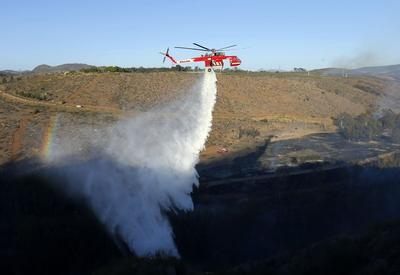 Central California wildfire burns out of control,...