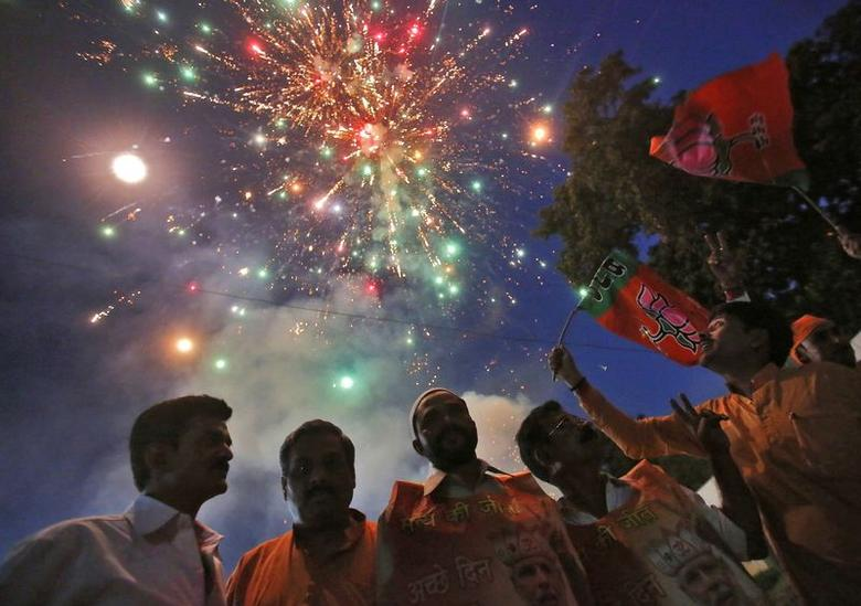 Fireworks explode as supporters of Bharatiya Janata Party (BJP) celebrate, after Narendra Modi was sworn in as India's prime minister, outside the BJP headquarters in New Delhi May 26, 2014. REUTERS/Anindito Mukherjee