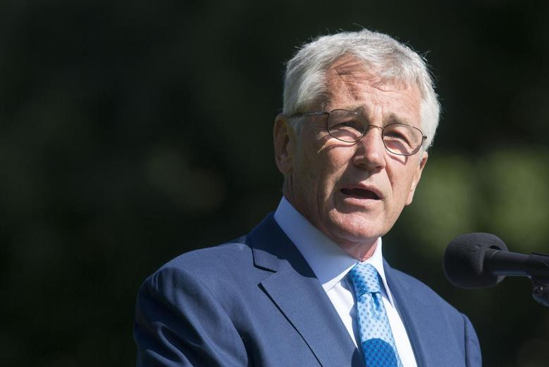 U.S. Defense Secretary Chuck Hagel speaks during the opening of the ''National Reading of the Names'' ceremony near the Vietnam Memorial in Washington May 24, 2014. REUTERS/Joshua Roberts