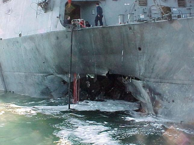 The port side damage to the guided missile destroyer USS Cole is pictured after a bomb attack during a refueling operation in the port of Aden in this October 12, 2000 file photo.  REUTERS/Aladin Abdel Naby/Files