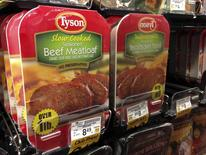REFILE - CLARIFYING FIRST SENTENCE Packages of Tyson food beef meat loaf are reflected in a mirror as they sit on a refrigerator for sale at a grocery store in Encinitas, California May 29,  2014.    REUTERS/Mike Blake