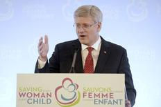 "Canada's Prime Minister Stephen Harper speaks during the closing news conference for the ""Saving Every Woman, Every Child: Within Arm's Reach"" Summit in Toronto May 30, 2014. REUTERS/Aaron Harris"