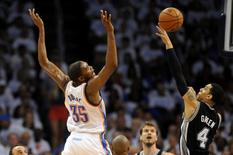 May 31, 2014; Oklahoma City, OK, USA; Oklahoma City Thunder forward Kevin Durant (35) loses the ball during a shot attempt against San Antonio Spurs guard Danny Green (4) during the fourth quarter in game six of the Western Conference Finals of the 2014 NBA Playoffs at Chesapeake Energy Arena. Mandatory Credit: Mark D. Smith-USA TODAY Sports