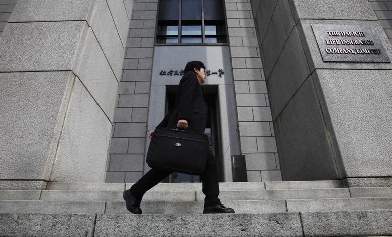 A man walks past Japan's Dai-ichi Life Insurance company headquarters building in Tokyo April 21, 2011.  REUTERS/Yuriko Nakao