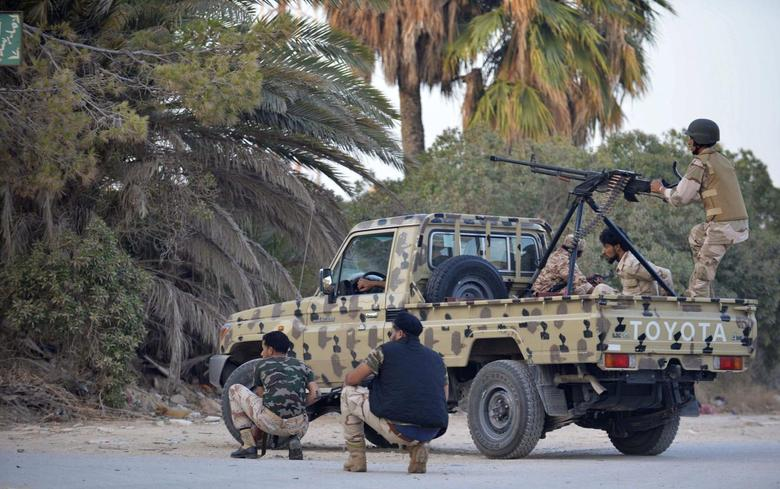 Irregular forces loyal to former army general Khalifa Haftar stand by an armed vehicle during clashes with Islamist militants in the eastern city of Benghazi June 2, 2014. REUTERS/Stringer