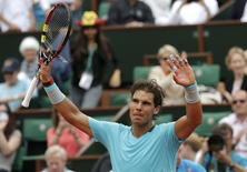 Rafael Nadal of Spain reacts after winning his men's singles match against Dusan Lajovic of Serbia at the French Open tennis tournament at the Roland Garros stadium in Paris June 2, 2014.          REUTERS/Jean-Paul Pelissier