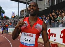 Tyson Gay of the U.S. gestures after winning in the 100m event of the Lausanne Diamond League meeting in Lausanne, July 4, 2013.             REUTERS/Denis Balibouse