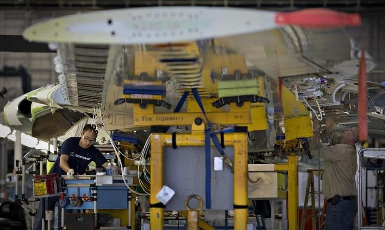 Workers assemble a wing for the Boeing 737-900 at their operations in Renton, Washington, October 18, 2012. REUTERS/Andy Clark