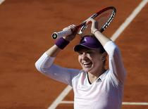 Simona Halep of Romania reacts after winning her women's quarter-final match against Svetlana Kuznetsova of Russia at French Open tennis tournament at the Roland Garros stadium in Paris June 4, 2014.             REUTERS/Gonzalo Fuentes