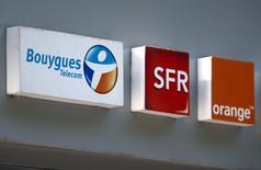 Orange a mandaté les banques Lazard et Credit suisse pour étudier le bien-fondé d'un rachat de son concurrent Bouygues Telecom dans le cadre d'une opération représentant plus de six milliards d'euros, a-t-on appris de deux sources au fait du dossier. /Photo prise le 16 mai 2014/REUTERS/Charles Platiau