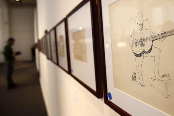 An untitled drawing of a four-eyed guitar player by John Lennon is seen during the press preview of a collection of Lennon's original drawings and manuscripts from 1964-65 at Sotheby's auction house in New York May 29, 2014.  REUTERS-Shannon Stapleton