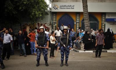 Gaza servants scuffle in unity government salary...