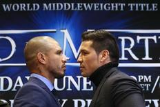 World Boxing Council (WBC) middleweight champion Sergio Martinez of Argentina (R) poses with three-division world champion Miguel Cotto of Puerto Rico during a press conference at Madison Square Garden in New York March 11, 2014.  REUTERS/Shannon Stapleton