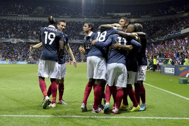 France's team members celebrate goal by Antoine Griezmann (11) during their international friendly match against Paraguay at the Allianz Riviera soccer stadium in Nice, June 1, 2014. REUTERS/Patrice Masante