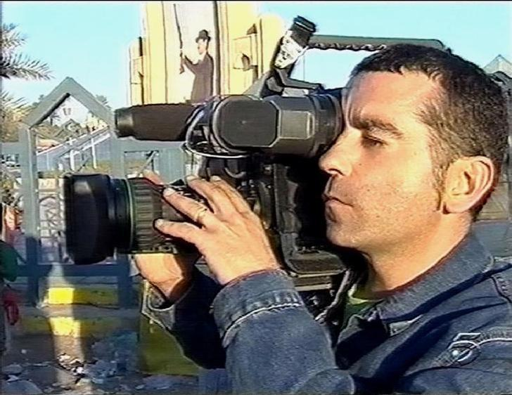 Undated file TV grab of Spanish TV cameraman Jose Couso, 37, who wasworking for Spanish TV channel Tele5, was killed along with Reuters TVcameraman Taras Protsyuk in Baghdad April 8, 2003. REUTERS/HO/Tele5