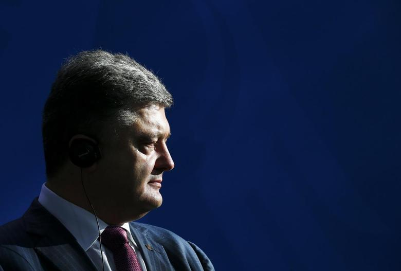 Ukrainian president-elect Petro Poroshenko listens to German Chancellor Angela Merkel (unseen) as they address the media before a meeting at the Chancellery in Berlin, June 5, 2014.  REUTERS/Thomas Peter