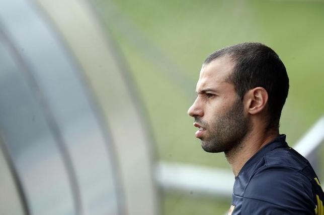 Barcelona's player Javier Mascherano attend a training session at Joan Gamper training camp, near Barcelona, March 31, 2014. REUTERS/Albert Gea/Files